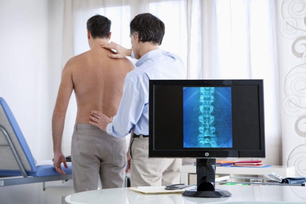 Chiropractor examining back