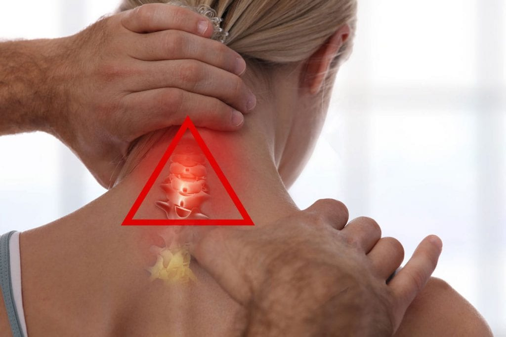 Whiplash neck pain being adjusted by chiropractor